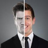 Homme d'affaires avec l'expression de deux visages Photographie stock libre de droits