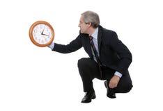 Homme d'affaires avec l'horloge Photographie stock libre de droits