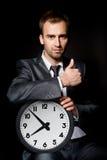 Homme d'affaires avec l'horloge Photos libres de droits