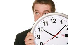 Homme d'affaires avec l'horloge Images stock