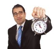Homme d'affaires avec l'horloge d'alarme photographie stock libre de droits