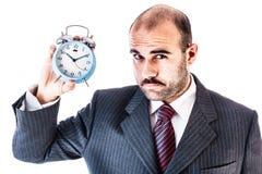 Homme d'affaires avec l'horloge d'alarme image stock