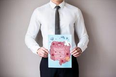Homme d'affaires avec l'intestin malade photo stock