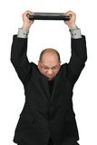 Homme d'affaires avec l'ordinateur au-dessus de sa tête Images libres de droits