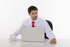 Homme d'affaires avec l'ordinateur portatif Photographie stock libre de droits