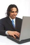 Homme d'affaires avec l'ordinateur portatif photos stock