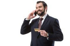 Homme d'affaires avec la carte de crédit et le smartphone Photos stock