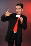 Homme d'affaires avec la carte en plastique. Photo stock
