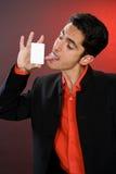 Homme d'affaires avec la carte en plastique. Humeur. Photographie stock