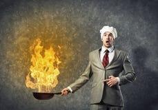 Homme d'affaires avec la casserole Photographie stock