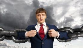 Homme d'affaires avec la chaîne énorme Photos stock