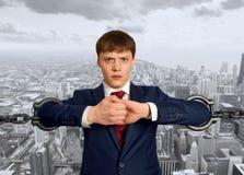Homme d'affaires avec la chaîne énorme Photographie stock libre de droits