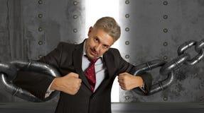 Homme d'affaires avec la chaîne énorme Image stock