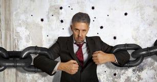 Homme d'affaires avec la chaîne énorme Image libre de droits