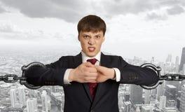 Homme d'affaires avec la chaîne énorme Photo libre de droits