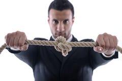 Homme d'affaires avec la corde d'isolement Photo stock