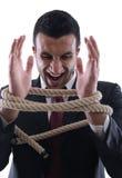 Homme d'affaires avec la corde d'isolement Photos libres de droits