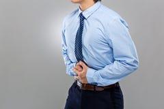 Homme d'affaires avec la diarrhée sérieuse Photographie stock libre de droits