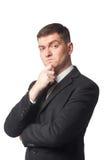 Homme d'affaires avec la main sur le menton Photos libres de droits