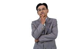 Homme d'affaires avec la main sur le menton Photographie stock libre de droits