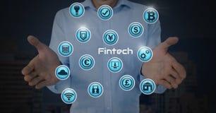 Homme d'affaires avec la paume de mains ouverte et Fintech avec de diverses icônes d'affaires Photographie stock libre de droits