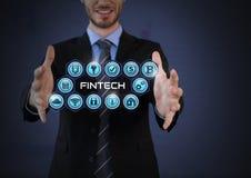 Homme d'affaires avec la paume de mains ouverte et Fintech avec de diverses icônes d'affaires Photos stock