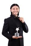 Homme d'affaires avec la récompense d'étoile d'isolement Photographie stock libre de droits