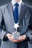 Homme d'affaires avec la récompense d'étoile Image libre de droits