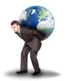 Homme d'affaires avec la terre sur le sien en arrière image libre de droits