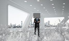 Homme d'affaires avec la TV au lieu de la tête Photos libres de droits