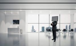 Homme d'affaires avec la TV au lieu de la tête Photo stock