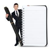 Homme d'affaires avec le bloc-notes et le stylo vides images libres de droits