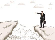 Homme d'affaires avec le bord tiré de la montagne Images libres de droits