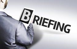 Homme d'affaires avec le briefing des textes dans une image de concept photographie stock