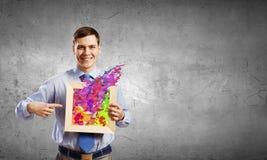 Homme d'affaires avec le cadre Photo stock
