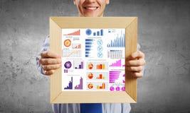 Homme d'affaires avec le cadre Image stock