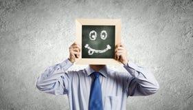 Homme d'affaires avec le cadre Photographie stock libre de droits