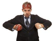 Homme d'affaires avec le chef meurtri photo libre de droits