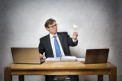 Homme d'affaires avec le cierge magique Photographie stock libre de droits