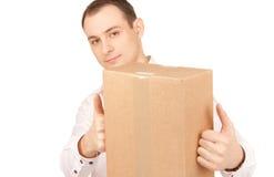 Homme d'affaires avec le colis Image libre de droits
