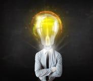 Homme d'affaires avec le concept de tête d'ampoule Image stock