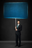 Homme d'affaires avec le conseil bleu Photographie stock