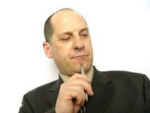 Homme d'affaires avec le crayon lecteur Image stock