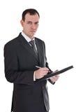 Homme d'affaires avec le crayon lecteur et le bloc-notes Image stock