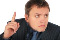 Homme d'affaires avec le doigt vers le haut Photographie stock