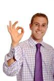 Homme d'affaires avec le geste EN BON ÉTAT Photographie stock libre de droits
