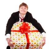 Homme d'affaires avec le grand cadre de cadeau. Photo libre de droits