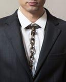 Homme d'affaires avec le lien à chaînes Image libre de droits