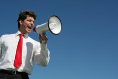Homme d'affaires avec le mégaphone Image stock