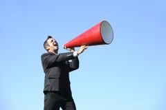 Homme d'affaires avec le mégaphone Photographie stock